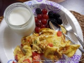 Assembled breakfast: eggs, homemade yogurt in jar, fresh fruit