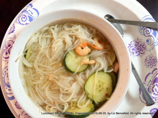 Bowl of lemongrass & chili soup with crushed red pepper, tapioca noodles, tiny shrimp and thin-sliced cucumber