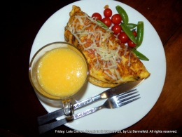 Cherry Tomatoes, Orange Juice and Snap Peas, Grated Swiss Cheese