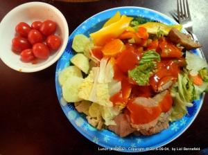 tossed salad with veggies, tomato and pork tenderloin.